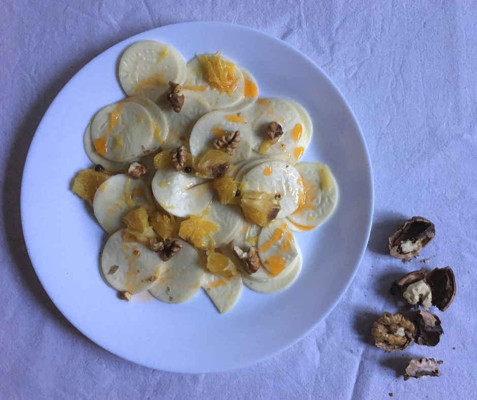 corzetti pasta with oranges, anchovies and walnuts