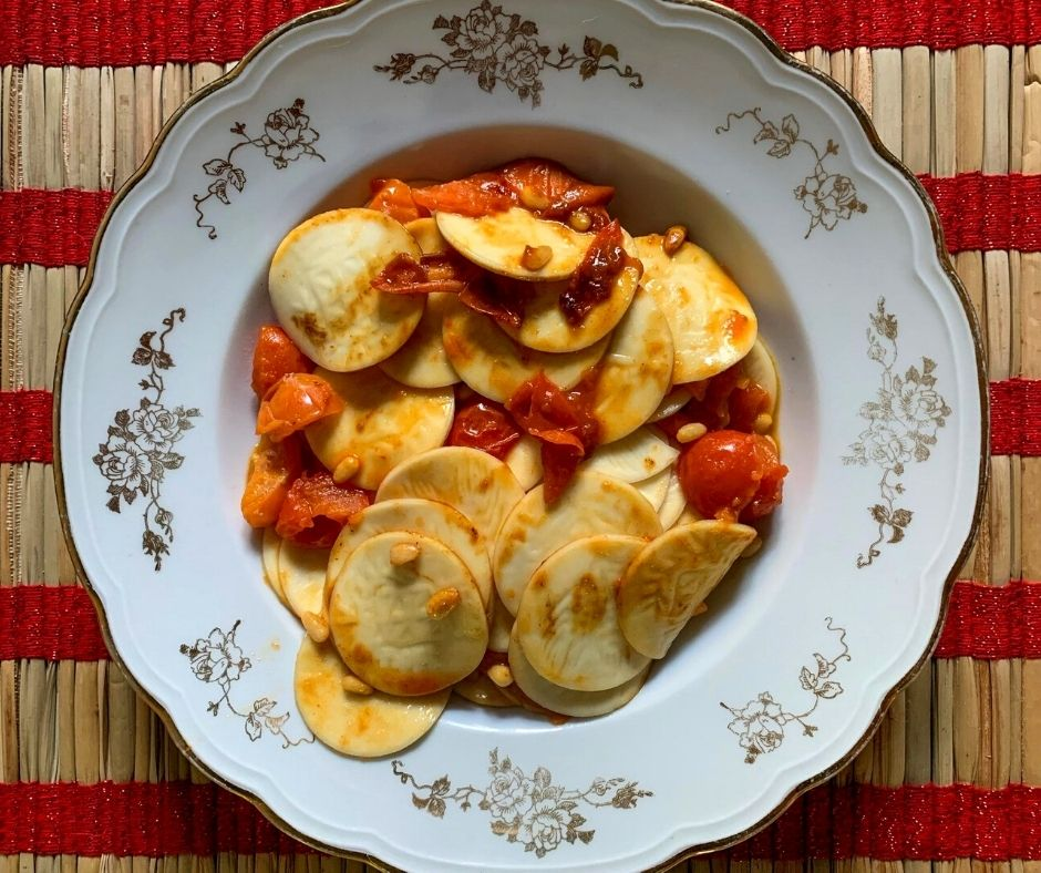 corzetti pasta with tomatoes and pine nuts